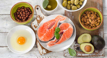sources: Food sources of  healthy fats. Diet eating.Top view Stock Photo