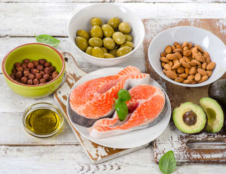unsaturated: Food sources of unsaturated fats and Omega 3. Healthy Diet concept. Stock Photo