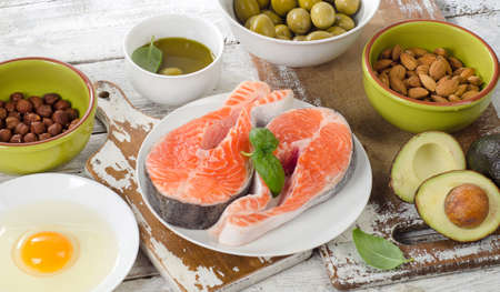 unsaturated: Food sources of unsaturated fats and Omega 3. Healthy eating concept. Stock Photo
