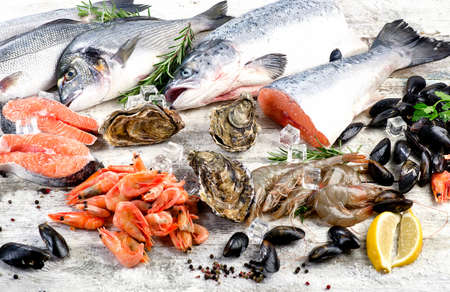 Fresh Fish and seafood with herbs and spices. Healthy diet eating. Closeup Stock Photo