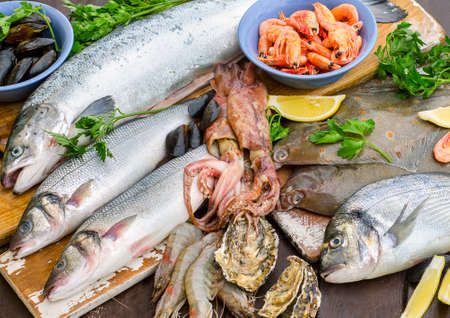 gilthead: Fresh seafood on a wooden table. Flat lay