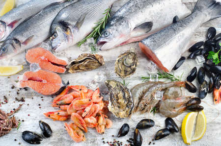 Fresh fish and seafood with aromatic herbs and spices. Healthy eating. Stock Photo