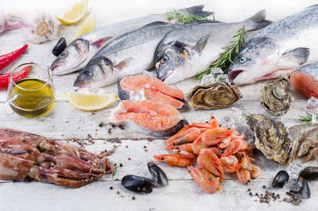 gilthead: Fish and seafood with fresh herbs and spices. Healthy diet eating. Closeup Stock Photo