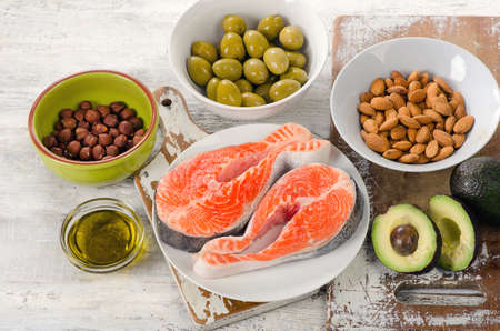 unsaturated: Food sources of  unsaturated fats. Healthy Diet eating. Stock Photo