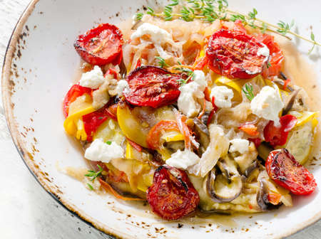 Cooked vegetables with feta cheese. Healthy diet eating. Top view
