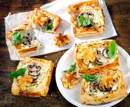 tarts: Mushroom tarts on wooden background. Top view Stock Photo