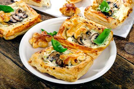 tarts: Puff pastry Mushroom tarts on wooden table.