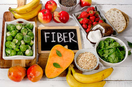 High Fiber Foods on  white wooden background. Flat lay Stock Photo - 63649162
