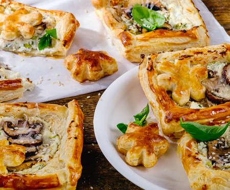 tarts: Puff pastry Mushroom tarts on wooden background.