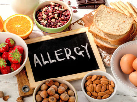 food allergy: Food allergy. Allergic food on  wooden background. Stock Photo