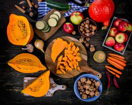 Autumn food composition on a dark wooden background. Stock Photo