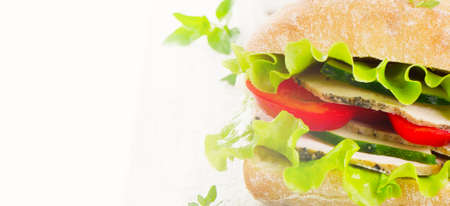 Fresh healthy sandwich  on a wooden cutting board isolated on white background. Selective focus