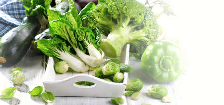 bok choy: Fresh green vegetables on  wooden table. Banner Stock Photo
