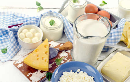 Dairy products on white wooden board. View from above