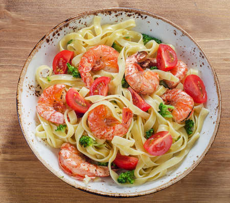 Pasta with shrimps and vegetables. Healthy eating concept. Top view