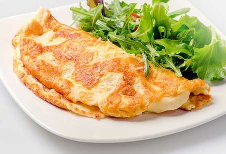 Omelette with fresh salad  for healthy breakfast. Reklamní fotografie