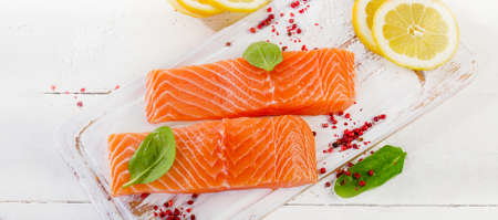 Fresh salmon fillet with herbs, spices and lemon. Healthy food. Diet concept. Top view. Banner. Panorama Imagens