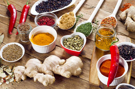 Colorful spices on a wooden background. Stock Photo