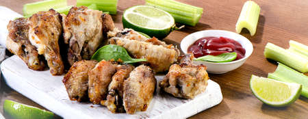 dipping: Grilled Chicken wings on wooden board