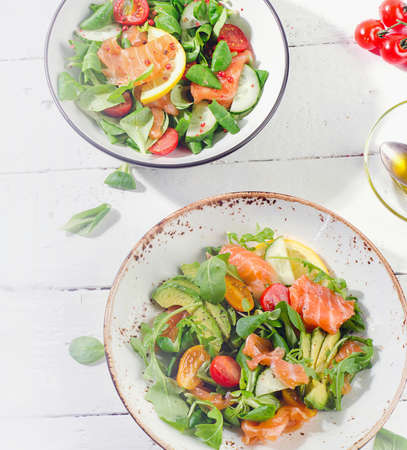Fresh Salmon salad with cherry tomatoes,  arugula, and avocado. Flat lay Reklamní fotografie