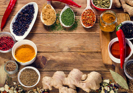 Colorful spices on wooden board. View from above