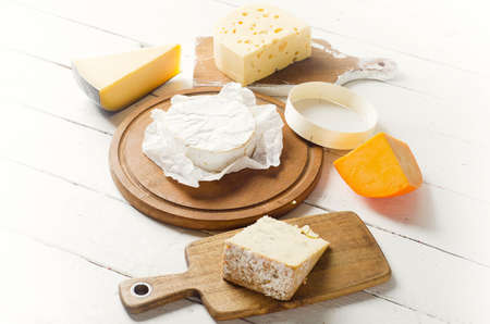 Cheese on a white wooden board. View from above Stock Photo