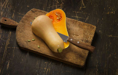 Butternut squash pumpkin on a rustic wooden background 스톡 콘텐츠