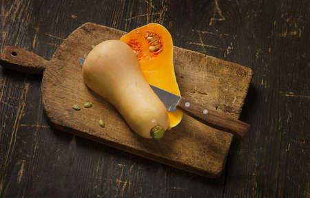 Butternut squash pumpkin on a rustic wooden background 스톡 콘텐츠