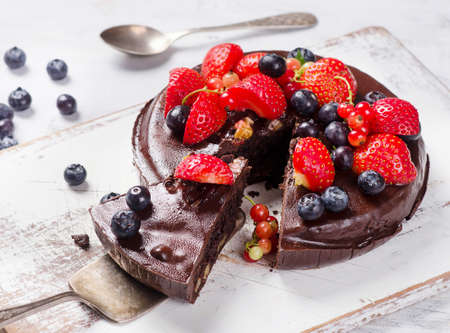 Chocolate cake with fresh different berries