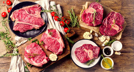 Raw beef meat on a dark wooden board. Top view Stok Fotoğraf - 83788007