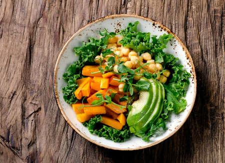 Chickpea, pumpkin and avocado vegetarian buddha bowl. Healthy food concept. Vegan food.