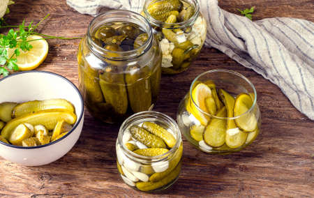 marinated gherkins: Marinated cucumbers gherkins. Pickles  on a wooden table.