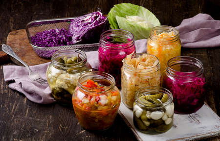 Fermented vegetables in jars. Vegetarian food concept