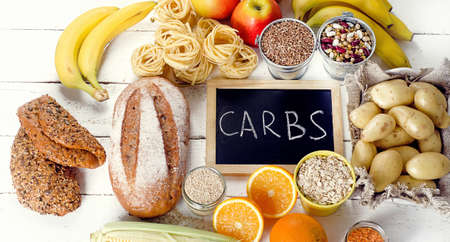 Best Sources of Carbs on a white wooden background. Top view Stock Photo