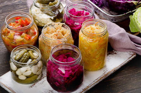Fermented vegetables in jars. Vegetarian food concept 免版税图像
