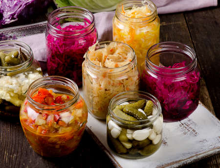 Fermented vegetables in jars. Vegetarian food concept Stock Photo