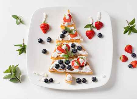 Dessert Christmas tree. New Year food background. Top view