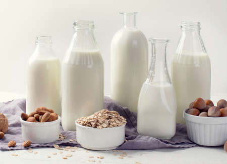 Alternative types of milks in glass bottles. Vegan non dairy milk