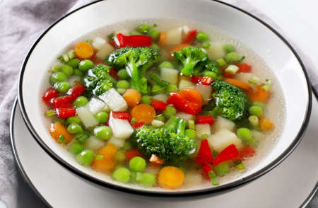 Vegetables soup with broccoli, green peas, carrots. Healthy food concept