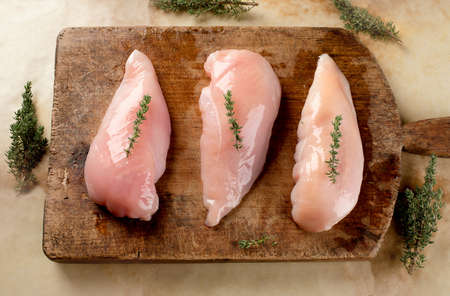 Raw chicken breast with thyme ready for cooking. Healthy eating concept Stok Fotoğraf