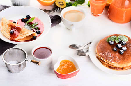 Healthy breakfast with coffee, pancakes, fresh berries and juice. Top view. Stock Photo
