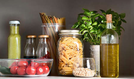 Kitchen pantry with italian food products. Healthy food concept. Banco de Imagens