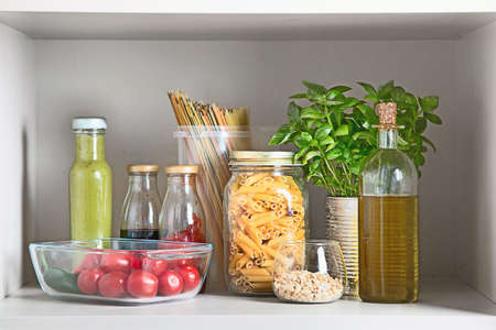 Kitchen pantry with italian food products. Healthy food concept. Banque d'images