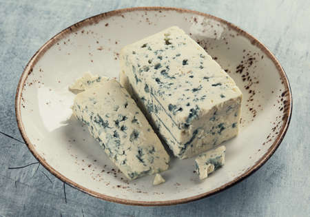 Blue cheese in a bowl. Stock Photo