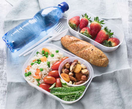 Healthy lunch boxes and bottle of water Stock Photo