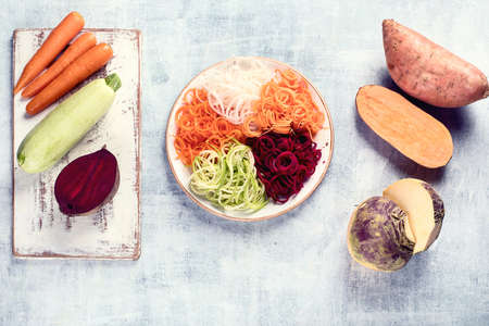 Vegetable noodles. Fresh zucchini, carrot, white radish, sweet potato  and beet root pasta