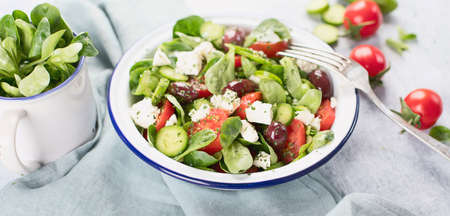 Fresh vegetable salad with feta cheese. Traditional greek salad Stock Photo