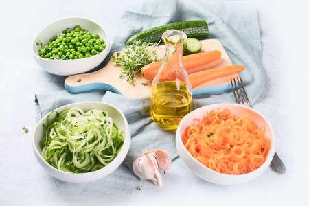 Fresh carrots, cucumbers and green peas. Healthy food. Vegan and vegetarian eating concept Stock Photo