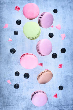 French sweet macaroons flying in motion. Stock Photo