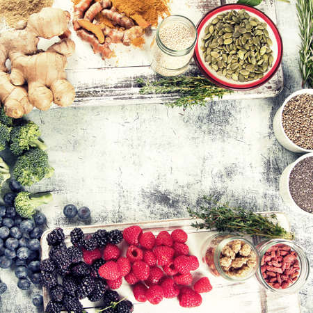 Various superfoods on white wooden board. Healthy food concept Stock Photo